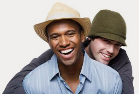 Men smiling with newly enhanced cosmetic smiles