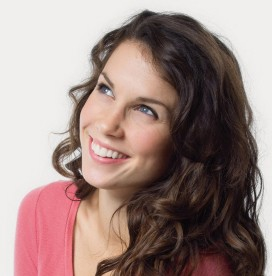 girl smiling with newly enhanced cosmetic smile